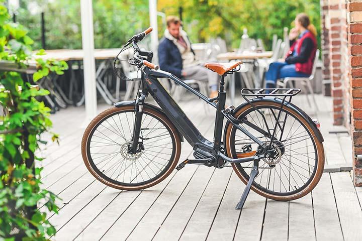 An O2feel e-bike on a wooden deck