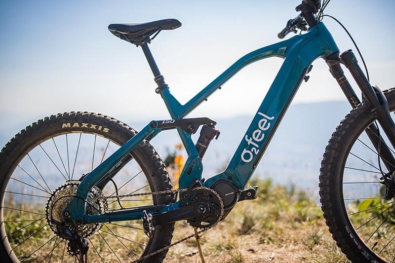 An electric O2feel mountain bike on a mountain ridge